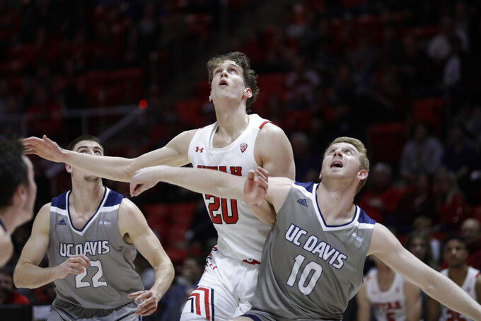 Utah forward Mikael Jantunen (20) and UC Davis forward Kennedy Koehler (10) work for position under the boards during the second half during an NCAA college basketball game Friday, Nov. 29, 2019, in Salt Lake City. (AP Photo/Rick Bowmer)