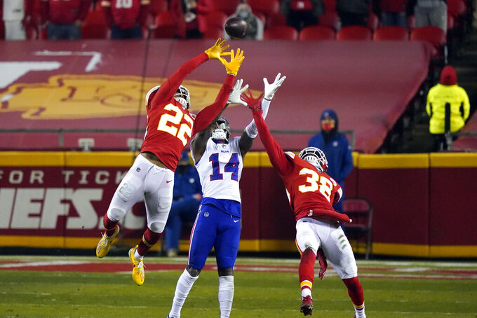 Kansas City Chiefs safety Juan Thornhill (22) and safety Tyrann Mathieu (32) break up a pass intended for Buffalo Bills wide receiver Stefon Diggs (14) during the second half of the AFC championship NFL football game, Sunday, Jan. 24, 2021, in Kansas City, Mo. (AP Photo/Jeff Roberson)