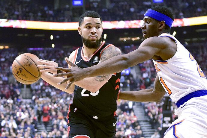 Toronto Raptors guard Fred VanVleet (23) drives to the net as New York Knicks guard Damyean Dotson (21) defends during first half NBA basketball action in Toronto, Monday, March 18, 2019. (Frank Gunn/The Canadian Press via AP)