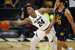 Colorado guard Eli Parquet, left, reaches out for the ball as California guard Matt Bradley defends in the second half of an NCAA college basketball game Thursday, Feb. 6, 2020, in Boulder, Colo. (AP Photo/David Zalubowski)