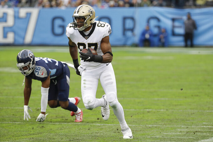 New Orleans Saints tight end Jared Cook (87) gets past Tennessee Titans cornerback LeShaun Sims (36) as Cook scores a touchdown against the New Orleans Saints in the first half of an NFL football game Sunday, Dec. 22, 2019, in Nashville, Tenn. (AP Photo/James Kenney)