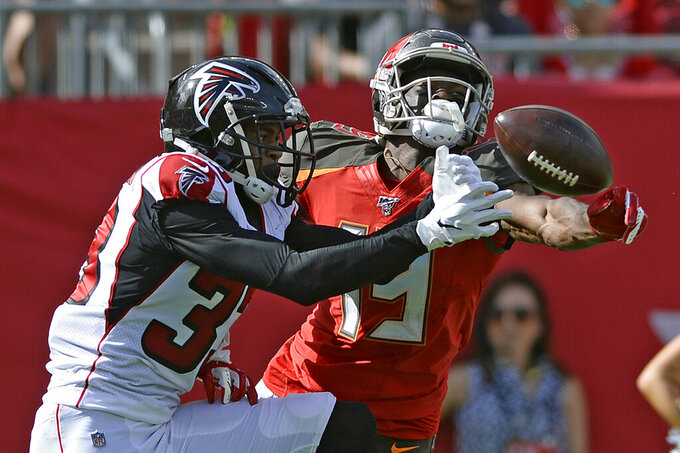 Atlanta Falcons defensive back Blidi Wreh-Wilson (33) breaks up a pass intended for Tampa Bay Buccaneers wide receiver Breshad Perriman (19) during the first half of an NFL football game Sunday, Dec. 29, 2019, in Tampa, Fla. (AP Photo/Jason Behnken)