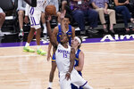 Sacramento Kings rookie guard Davion Mitchell, left, goes to the basket against Golden State Warriors forward Nick Mayo, right, during the first half of a California Classic NBA summer league basketball game in Sacramento, Calif., Tuesday, Aug. 3, 2021. (AP Photo/Rich Pedroncelli)