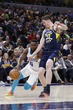 Charlotte Hornets' Shelvin Mack (6) goes to the basket against Indiana Pacers' T.J. Leaf (22) during the first half of an NBA basketball game, Monday, Feb. 11, 2019, in Indianapolis. (AP Photo/Darron Cummings)