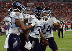 Tennessee Titans corenrback Briean Boddy-Calhoun (36) celebrates recovering a fumble by the Tampa Bay Buccaneers and returning it 42-yards for a score during the second half of an NFL preseason football game Saturday, Aug. 21, 2021, in Tampa, Fla. (AP Photo/Jason Behnken)
