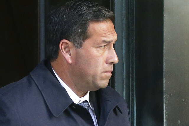 FILE - In this March 25, 2019 file photo Jorge Salcedo, former University of California at Los Angeles men's soccer coach, departs federal court in Boston, after facing charges in a nationwide college admissions bribery scandal. Salcedo, former University of California, Los Angeles men's soccer coach, pleaded guilty Monday, July 27, 2020 to accepting $200,000 in bribes to help two students get into the school as recruits. Salcedo admitted to participating in the college admissions bribery scheme involving TV celebrities, other wealthy parents and elite universities across the country. (AP Photo/Steven Senne, File)