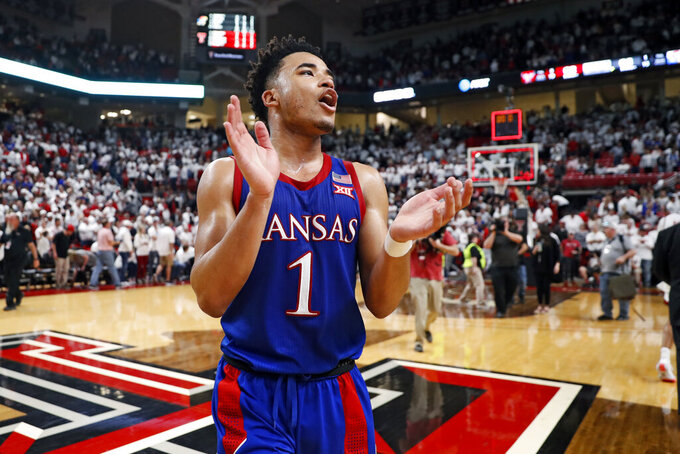 Kansas' Devon Dotson (1) celebrates after an NCAA college basketball game against Texas Tech, Saturday, March 7, 2020, in Lubbock, Texas. (AP Photo/Brad Tollefson)