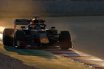 Red Bull driver Pierre Gasly of France steers his car during a Formula One pre-season testing session at the Barcelona Catalunya racetrack in Montmelo, outside Barcelona, Spain, Thursday, Feb.21, 2019. (AP Photo/Joan Monfort)