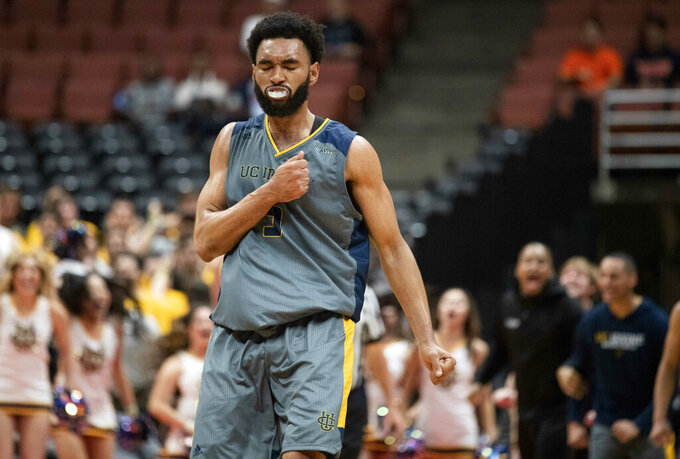 UC Irvine forward Jonathan Galloway gestures after scoring during the second half of the team's NCAA college basketball game against Long Beach State at the Big West men's tournament in Anaheim, Calif., Friday, March 15, 2019. (AP Photo/Kyusung Gong)