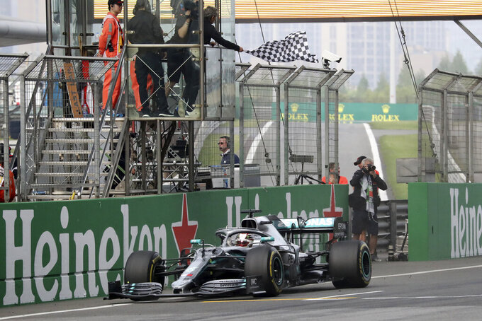 Mercedes driver Lewis Hamilton of Britain drives past the checkered flag to win the Chinese Formula One Grand Prix at the Shanghai International Circuit in Shanghai on Sunday, April 14, 2019. (AP Photo/Ng Han Guan)