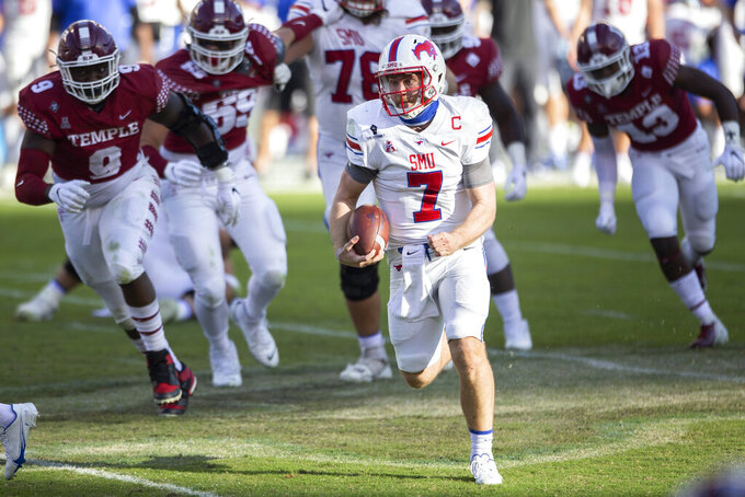 SMU quarterback Shane Buechele (7) runs with the ball during the second half of an NCAA college football game against Temple, Saturday, Nov. 7, 2020, in Philadelphia. SMU won 47-23. (AP Photo/Laurence Kesterson)