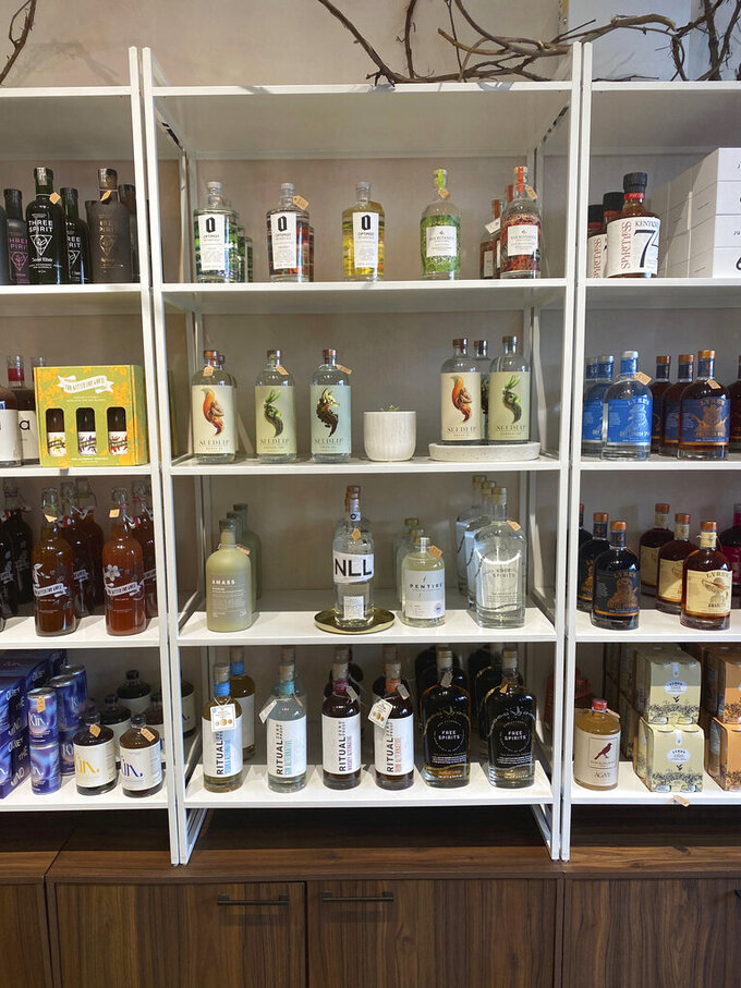 Non-alcoholic spirits are displayed at Boisson in New York in August 2021. Interest in a sober lifestyle has been growing for years, leading to the rise of mocktails and alcohol-free bars. The pandemic led even more people to question boozy drinking habits. Non-alcoholic options range from drinks that aim to replicate existing spirits to ones that promise something completely new. (Katie Workman via AP)