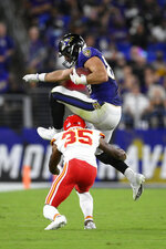 Baltimore Ravens tight end Mark Andrews leaps over Kansas City Chiefs cornerback Charvarius Ward as he rushes the ball in the first half of an NFL football game, Sunday, Sept. 19, 2021, in Baltimore. (AP Photo/Nick Wass)