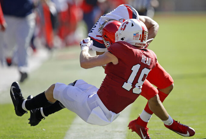 Stanford's Stuart Head (18) tackles Arizona's Tayvian Cunningham in the first half of an NCAA college football game Saturday, Oct. 26, 2019, in Stanford, Calif. (AP Photo/Ben Margot)