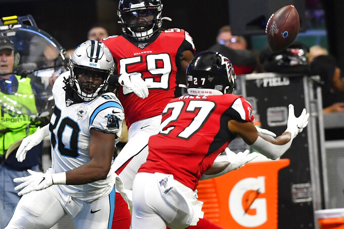 Atlanta Falcons strong safety Damontae Kazee (27) picks off a passed ball intended for Carolina Panthers tight end Ian Thomas (80) during the first half of an NFL football game, Sunday, Dec. 8, 2019, in Atlanta. (AP Photo/John Amis)