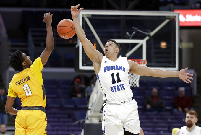 Valparaiso's Javon Freeman (0) and Indiana State's Tyreke Key (11) reach for a loose ball during the second half of an NCAA college basketball game in the first round of the Missouri Valley Conference men' tournament Thursday, March 7, 2019, in St. Louis. (AP Photo/Jeff Roberson)