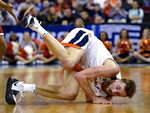 Virginia's Jay Huff takes a tumble after chasing a loose ball during the second half of a second round men's college basketball game against Oklahoma in the NCAA Tournament in Columbia, S.C. Sunday, March 24, 2019. (AP Photo/Richard Shiro)