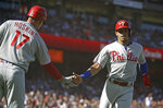Philadelphia Phillies' Cesar Hernandez, right, is congratulated by Rhys Hoskins (17) after scoring against the San Francisco Giants in the second inning of a baseball game Sunday, Aug. 11, 2019, in San Francisco. (AP Photo/Ben Margot)