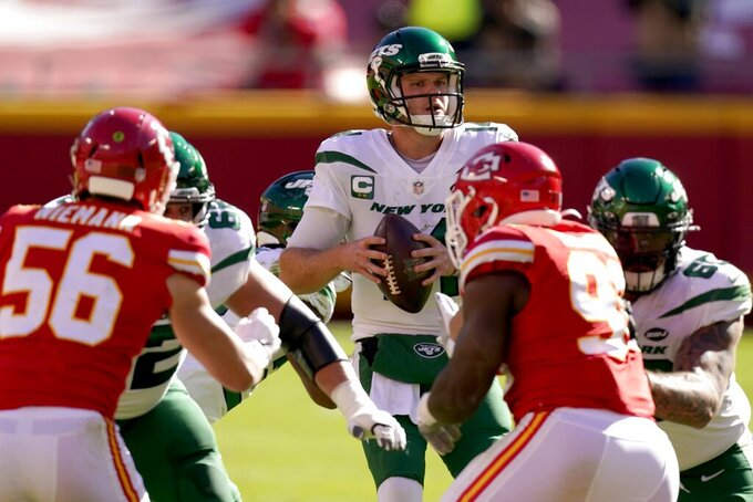 Kansas City Chiefs linebacker Ben Niemann (56) and defensive tackle Tershawn Wharton (98) pressure as New York Jets quarterback Sam Darnold, center, attempts to throw a pass in the first half of an NFL football game on Sunday, Nov. 1, 2020, in Kansas City, Mo. (AP Photo/Charlie Riedel)