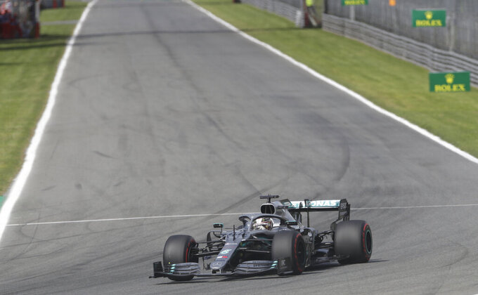 Mercedes driver Lewis Hamilton of Britain steers his car during the qualifying session at the Monza racetrack, in Monza, Italy, Saturday, Sept. 7, 2019. The Formula one race will be held on Sunday. (AP Photo/Luca Bruno)