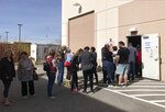 Democratic caucus-goers wait more than an hour in line in an early caucus ballot precinct site at an AFL-CIO union office in Henderson, Nev., Saturday, Feb. 15, 2020. Voters filled out ballots with first, second and third choice picks, to be tallied Saturday, Feb. 22, in the Nevada Democratic Party caucus. (AP Photo by Ken Ritter)