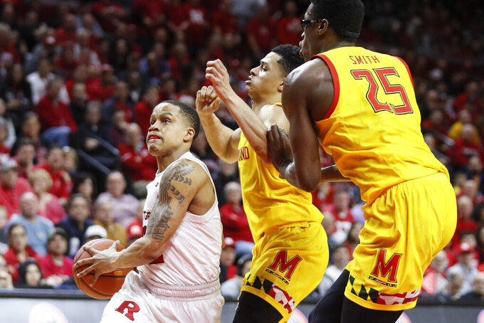 Rutgers' Jacob Young, left, drives past Maryland's Anthony Cowan Jr., center, and Jalen Smith (25) during the second half of an NCAA college basketball game Tuesday, March 3, 2020, in Piscataway, N.J. (AP Photo/John Minchillo)