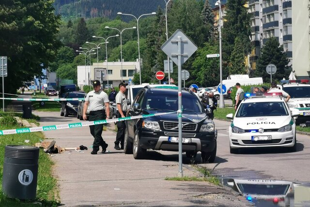 Police officers attend an incident at the primary and secondary school in Vrutky (Zilina region), Slovakia, Thursday, June 11, 2020. Police say a man with a knife attacked a school in Slovakia on Thursday, killing one person before he was killed by police. (Erika Durcova/TASR via AP)