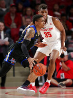 Tulsa guard DaQuan Jeffries (2) drives into Houston forward Fabian White Jr. (35) during the first half of an NCAA college basketball game Wednesday, Jan. 2, 2019, in Houston. (AP Photo/Michael Wyke)