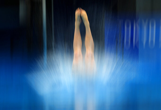 Sofiia Lyskun of Ukraine competes in women's diving 10-meter platform preliminary at the 2020 Summer Olympics, Wednesday, Aug. 4, 2021, in Tokyo, Japan. (AP Photo/Dmitri Lovetsky)