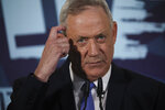 FILE - In this Nov. 20, 2019 file photo, Blue and White party leader Benny Gantz, addresses media in Tel Aviv, Israel. Barring a nearly unfathomable about face, Israel is headed Wednesday, Dec. 11 toward an unprecedented third election within a year - prolonging a political stalemate that has paralyzed government and undermined its citizens' faith in the democratic process. (AP Photo/Oded Balilty, File)