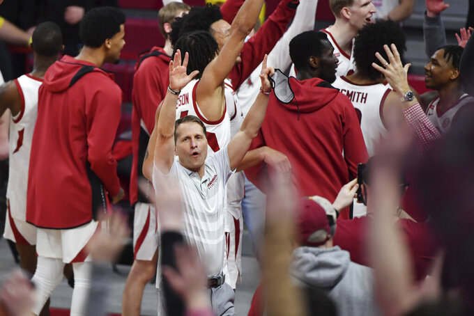 Arkansas coach Eric Musselman calls the hogs with his team after beating Alabama 81-66 during the second half of an NCAA college basketball game in Fayetteville, Ark. Wednesday, Feb. 24, 2021. (AP Photo/Michael Woods)