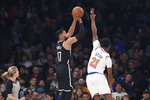Brooklyn Nets guard Garrett Temple (17) shoots for three points as New York Knicks guard Damyean Dotson (21) defends during the first half of an NBA basketball game in New York, Sunday, Jan. 26, 2020. (AP Photo/Kathy Willens)