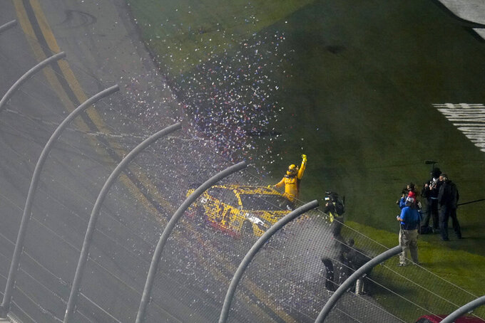 Michael McDowell celebrates after winning the NASCAR Daytona 500 auto race at Daytona International Speedway, Monday, Feb. 15, 2021, in Daytona Beach, Fla. (AP Photo/Chris O'Meara)