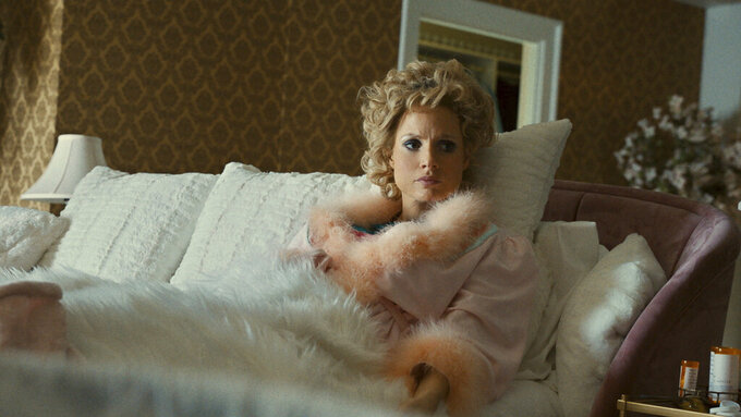 """This image released by Searchlight Pictures shows Jessica Chastain as Tammy Faye Bakker in a scene from """"The Eyes of Tammy Faye."""" (Searchlight Pictures via AP)"""