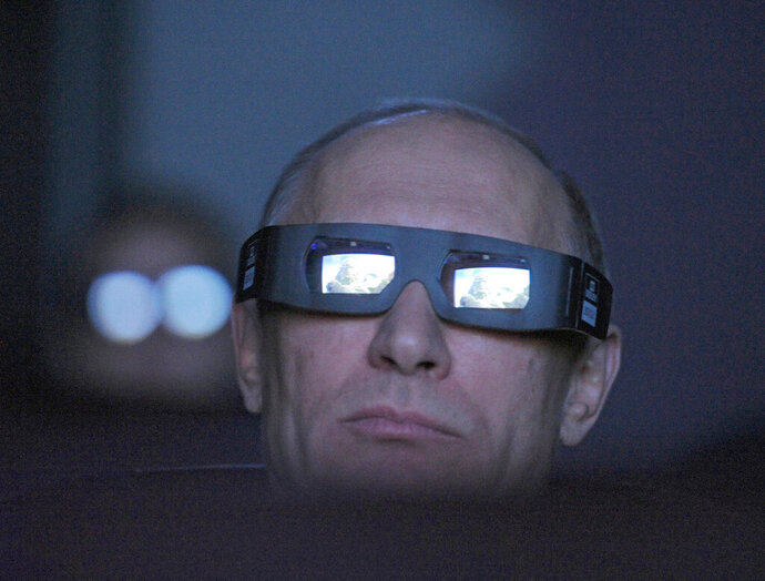 FILE In this file photo taken on Thursday, April 12, 2012, Russian Prime Minister Vladimir Putin wears 3D glasses as he visits Moscow's Planetarium in Moscow, Russia. Russian President Vladimir Putin prepares to mark his 20th year in power, as the longest-serving leader since Joseph Stalin. (AP Photo/Sputnik, Alexei Druzhinin, Government Press Service, File)