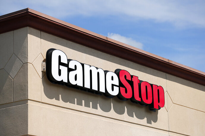 FILE - In this May 7, 2020 file photo, a GameStop store is seen in St. Louis. Two hedge funds are bowing out of their short positions on the money-losing video game retailer. Citron Research's Andrew Left said in a video posted on YouTube that his company is going to become more judicious in shorting stocks. Melvin Capital is also exiting GameStop, with manager Gabe Plotkin telling CNBC that the hedge fund was taking a significant loss. (AP Photo/Jeff Roberson, File)