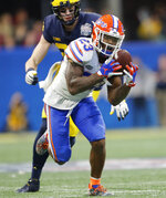 Florida defensive back Chauncey Gardner-Johnson (23) makes the catch for an interception against Michigan during the second half of the Peach Bowl NCAA college football game, Saturday, Dec. 29, 2018, in Atlanta. Florida won 41-15. (AP Photo/John Bazemore)