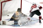 New Jersey Devils center Blake Coleman (20) scores a breakaway goal against Boston Bruins goaltender Jaroslav Halak (41) during the third period of an NHL hockey game Thursday, Dec. 27, 2018, in Boston. (AP Photo/Elise Amendola)