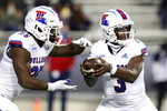 Louisiana Tech running back Greg Garner (25) and quarterback Aaron Allen (3) fake a handoff against TCU in the first half during an NCAA college football game, Saturday, Dec. 12, 2020. (AP Photo/Richard W. Rodriguez)