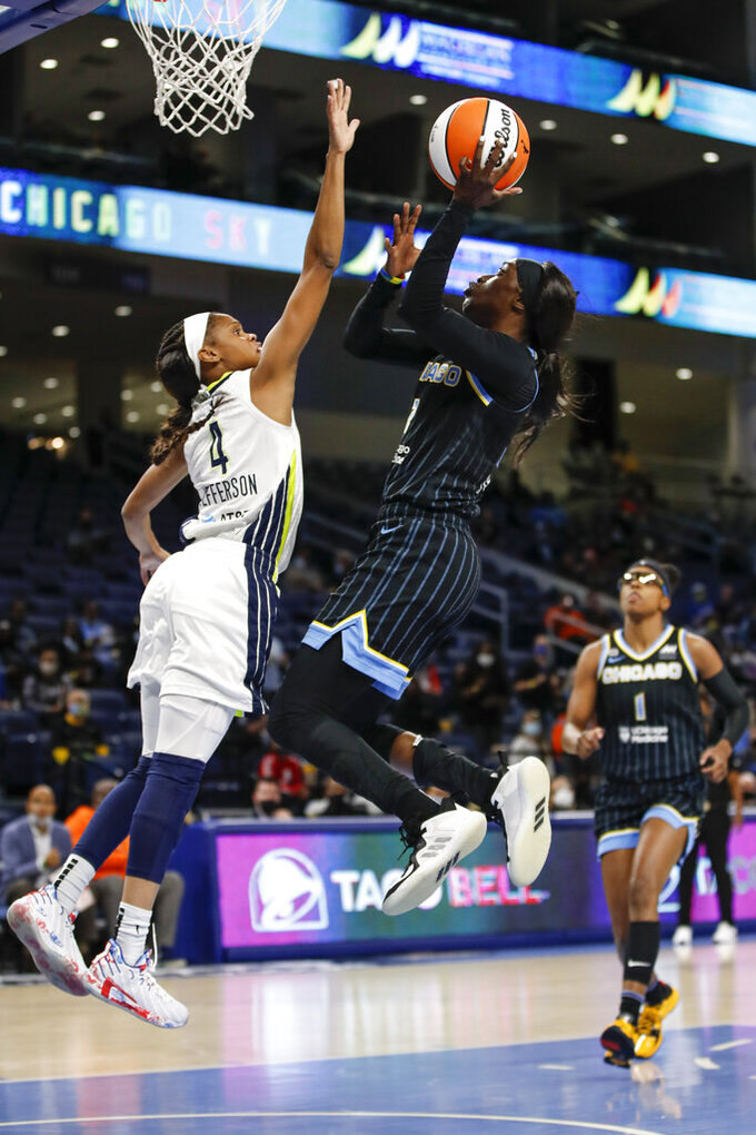 Chicago Sky guard Kahleah Copper (2) shoots against Dallas Wings guard Moriah Jefferson (4) during the first half in the first round of the WNBA basketball playoffs, Thursday, Sept. 23, 2021, in Chicago. (AP Photo/Kamil Krzaczynski)