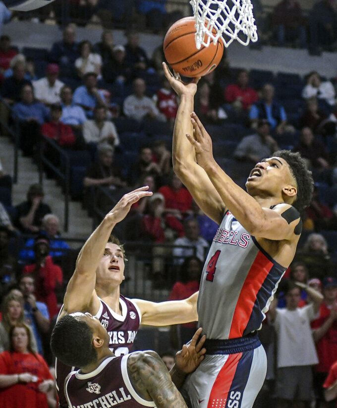 Mississippi guard Breein Tyree (4) shoots against Texas A&M's Chris Collins (12) and Wendell Mitchell (11) during an NCAA college basketball game, Wednesday, Feb. 6, 2019 in Oxford, Miss. (Bruce Newman/The Oxford Eagle via AP)