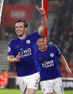 Leicester's Ben Chilwell celebrates scoring the opening goal during the English Premier League soccer match between Southampton and Leicester City at St Mary's stadium in Southampton, England Friday, Oct., 25, 2019. (AP Photo/Alastair Grant)