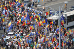 Protesters block traffic outside the government headquarters, in Bucharest, Romania, Friday, Aug. 10, 2018. Romanians who live abroad have begun an anti-government protest calling on the left-wing government to resign and an early election. The expatriates, some of whom drove across Europe for the demonstration, are angry about the Romania is governed.(AP Photo/Vadim Ghirda)