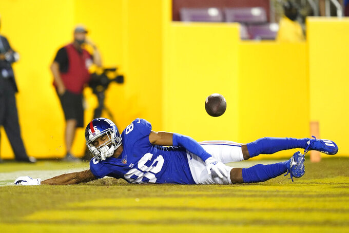 New York Giants wide receiver Darius Slayton (86) drops a pass as he goes sliding into the end zone during the second half of an NFL football game against the Washington Football Team, Thursday, Sept. 16, 2021, in Landover, Md. (AP Photo/Patrick Semansky)