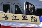 """Taiwan's President Tsai Ing-wen gives a """"thumbs up"""" on the domestically made Tajiang warship during its commissioning ceremony at the Suao naval base in Yilan county, Taiwan, Thursday, Sept. 9, 2021. Taiwan's president oversaw the commissioning of a new domestically made navy warship Thursday as part of the island's plan to boost indigenous defense capacity amid heightened tensions with China. Chinese characters read """"Ta Jiang Warship."""" (AP Photo/Chiang Ying-ying)"""