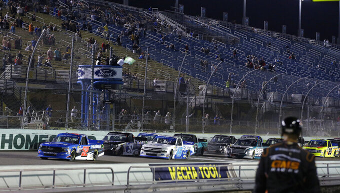 Stewart Friesen leads the pack to start a NASCAR Truck Series auto race on Friday, Nov. 15, 2019, at Homestead-Miami Speedway in Homestead, Fla. Friesen is one of four drivers racing for the series championship. (AP Photo/Terry Renna)