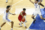 Richmond's Isaiah Wilson, middle, passes the ball near Kentucky's B.J. Boston, left, and Devin Askew (2) during the first half of an NCAA college basketball game in Lexington, Ky., Sunday, Nov. 29, 2020. (AP Photo/James Crisp)