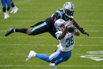 Carolina Panthers strong safety Juston Burris breaks up a pass intended for Detroit Lions wide receiver Jamal Agnew during the second half of an NFL football game Sunday, Nov. 22, 2020, in Charlotte, N.C. (AP Photo/Gerry Broome)