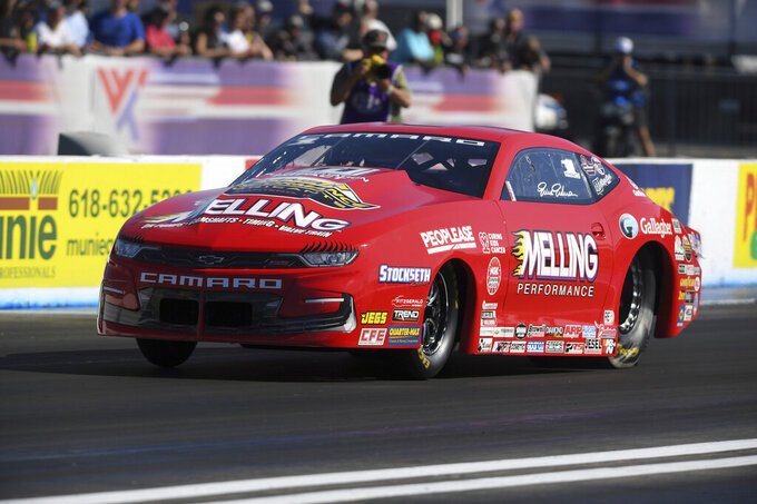 In this photo provided by the NHRA, Pro Stock's Erica Enders in the final round at the NHRA Midwest Nationals auto race at World Wide Technology Raceway, Sunday, Sept. 26, 2021, in Madison, Ill. (Jerry Foss/NHRA/National Dragster via AP)