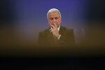 EU Migration Commissioner Dimitris Avramopoulos listens to a question during a news conference at the European Commission headquarters in Brussels, Wednesday, Jan. 23, 2019. The European Union is warning countries running lucrative schemes granting passports and visas to rich foreigners to toughen checks on applicants amid concern they could be flouting security and tax laws. (AP Photo/Francisco Seco)